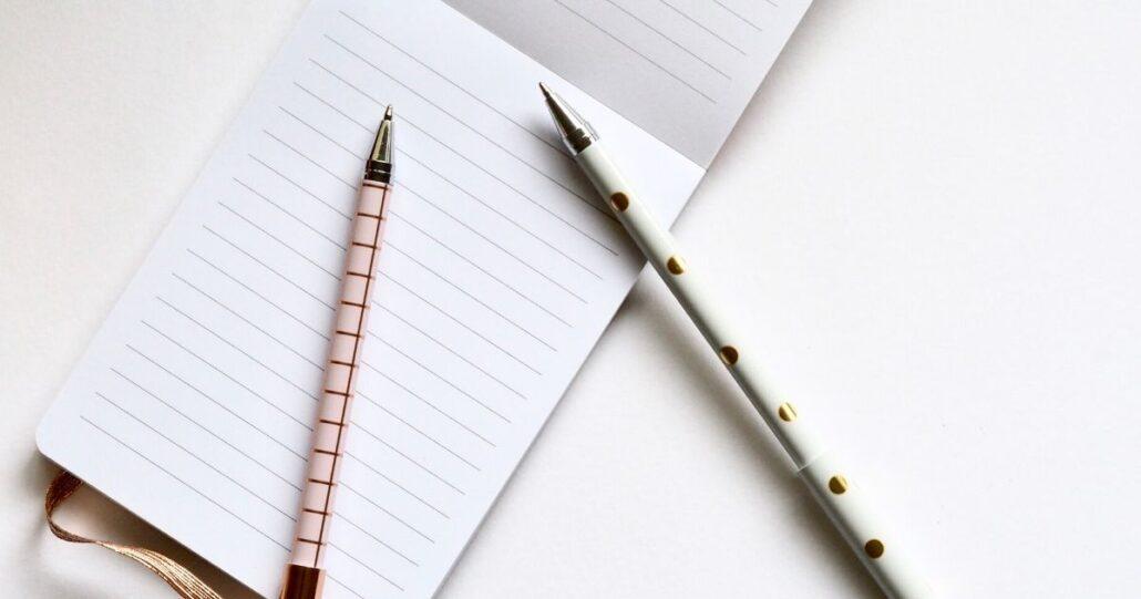 Feminine pens on blank lined paper.