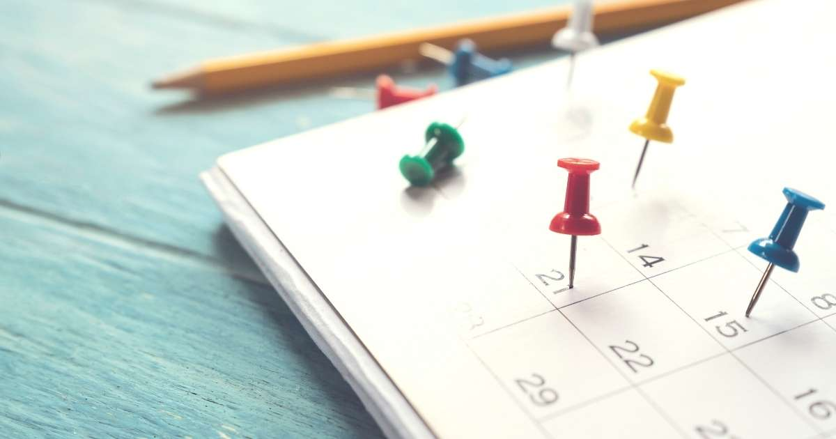 Pins on a calendar.